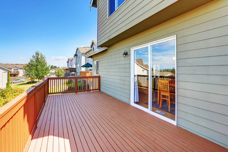 northwest: Empty wooden walkout deck with neighborhood view. Northwest, USA Stock Photo
