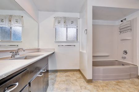 tile flooring: Old style bathroom with shower and vanity cabinet,  also tile flooring. Northwest, USA