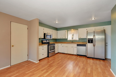 remodeled: Remodeled kitchen with stainless steel appliances and white cabinets. Northwest, USA