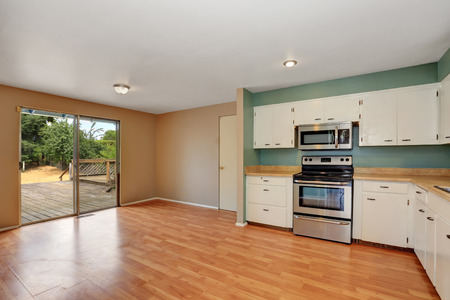 remodeled: Remodeled kitchen with stainless steel appliances and hardwood floor. Has exit to the back deck. Northwest, USA