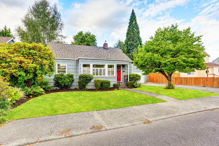 american house: Exterior of small American house with blue paint. Northwest, USA Stock Photo