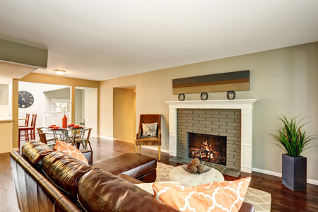 open floor plan: Cozy living room with fireplace and leather sofa. Open floor plan. Northwest, USA