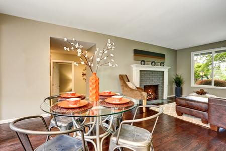 Open floor plan. Modern dining area with glass table. Hardwood floor. Northwest, USA Stock Photo