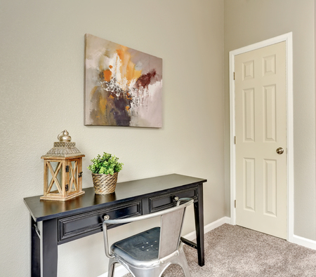 Hallway interior with black wooden table and armchair. Northwest, USA