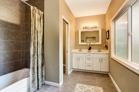 renovated: Bathroom interior with nice vanity and tile trim. Northwest, USA Stock Photo