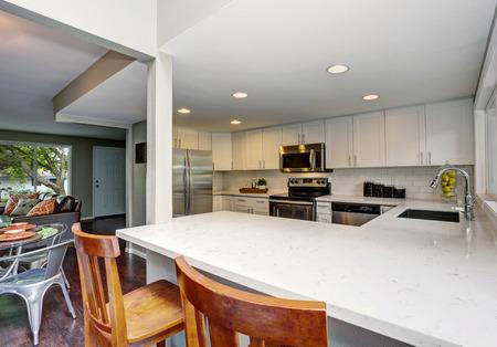 open floor plan: Open floor plan. White kitchen room interior. Northwest, USA Stock Photo