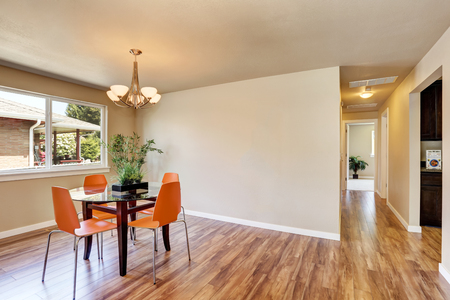 orange chairs: Modern dining area with orange chairs and glass table. Northwest, USA