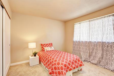 teen bedroom: Modern teen bedroom interior with red bedding. Northwest, USA