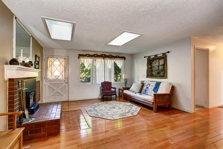 traditional living room: Traditional living room interior with brick fireplace and hardwood floor. Northwest, USA Stock Photo