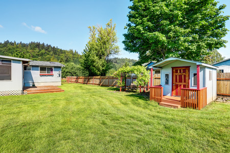 fenced: Fenced backyard with barn shed and hanging swing with nice landscape desing. Northwest, USA