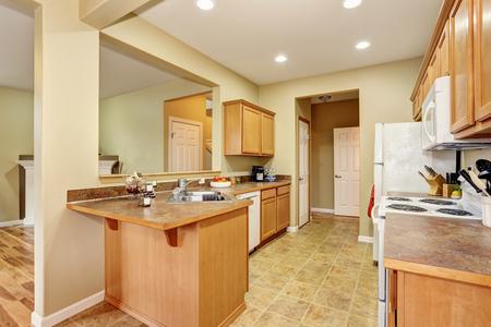Kitchen room interior with tile floor. Open floor plan. Northwest, USA