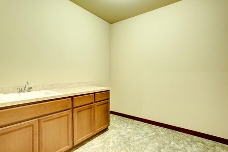 bathroom tile: Empty bathroom interior with vanity cabinet and tile floor. Northwest, USA