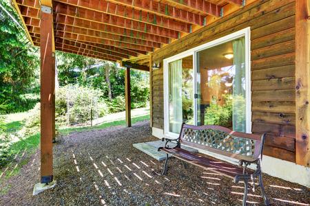 garden styles: Backyard wooden trim house covered patio area . Northwest, USA