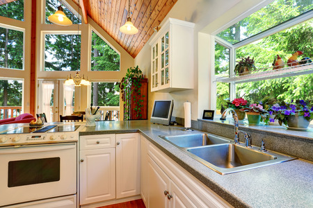 counter top: Classic American white kitchen interior with granite counter top and hardwood floor. Open floor plan. Northwest, USA Stock Photo