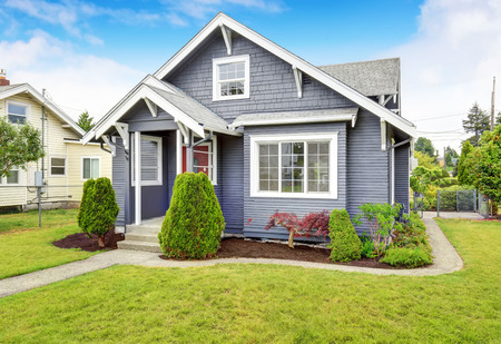 trim: Classic American house exterior with siding trim, red entry door and concrete floor porch. Northwest, USA