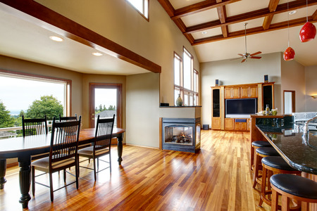 Open floor plan. Living room, kithen and dining area with hardwood floor. Northwest, USA Stock Photo