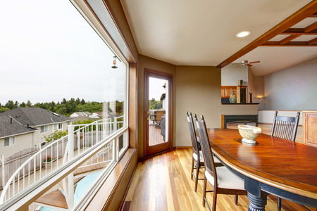 Open floor plan dining area with big window and perfect city view. Northwest, USA