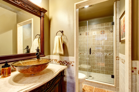 vessel sink: Bathroom interior in luxury house. Rich bathroom vanity cabinet with vessel sink and mirror. View of shower. Northwest, USA Stock Photo