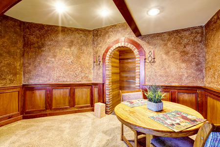 Luxury dining room interior with wooden trim and carpet floor. Northwest, USA