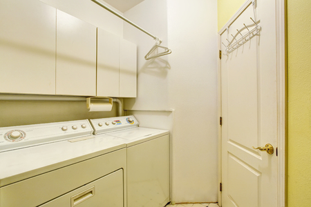 laundry room: Traditional laundry room with tile floor, and washer dryer combo. Northwest, USA Stock Photo