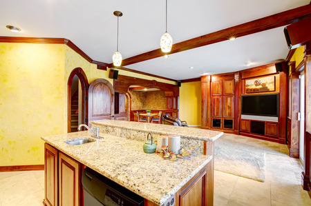 Open floor plan. View of living room and dining area. Kitchen island with granite top an the foreground. Northwest, USA