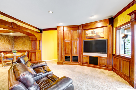 Open floor plan. Living room interior with tv set connected to dining area. Northwest, USA