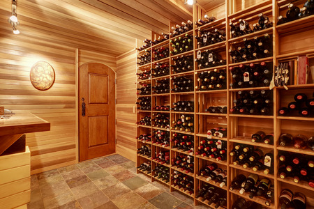 storage units: Bright home wine cellar with wooden storage units and arch with bottles. Northwest, USA