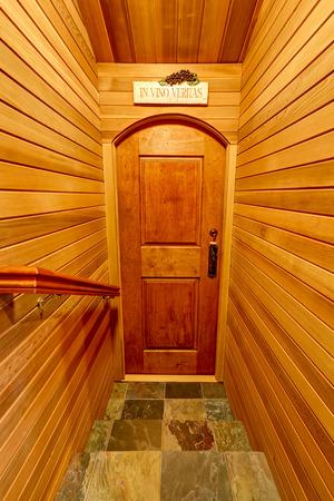 pannel: Hallway interior with pannel wooden trim. Door to home wine cellar. Northwest, USA
