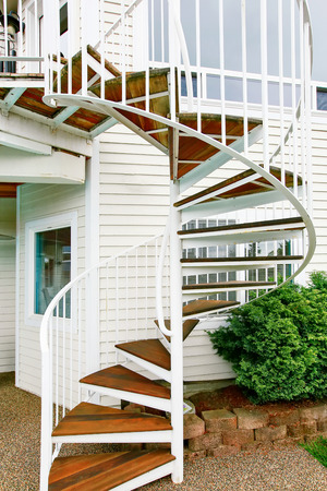 emergency stair: Spiral staircase on the outside the house. Northwest, USA