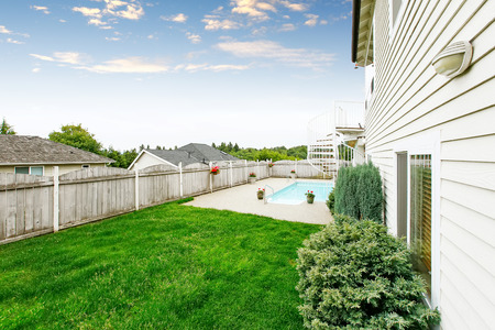 lawn area: Spacious backyard area with wooden fence, swimming pool and well kept green lawn. Northwest, USA