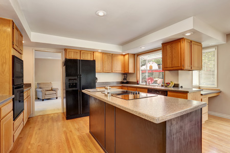 northwest: Kitchen room interior with with granite counter top and island. Northwest, USA