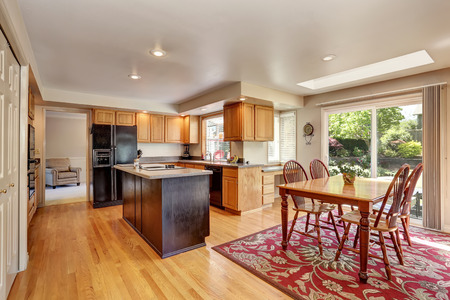renovated: Kitchen room interior with with granite counter top and island. Also dining area. Northwest, USA Stock Photo