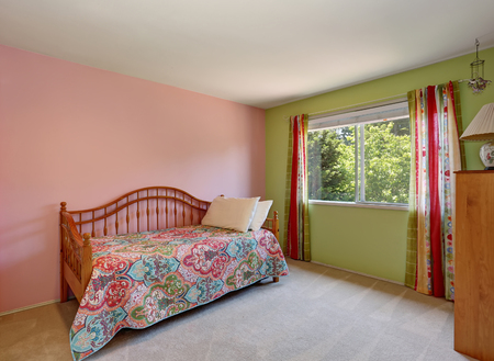 Modern pink adult bedroom interior. Also green wall and colorful curtains. Northwest, USA