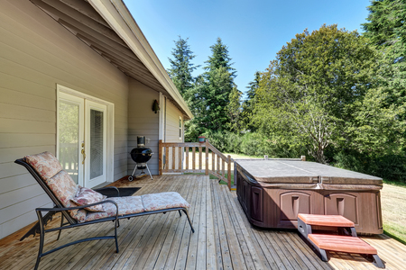 deck: Backyard house exterior with patio area and hot tub on the walkout deck. Northwest, USA