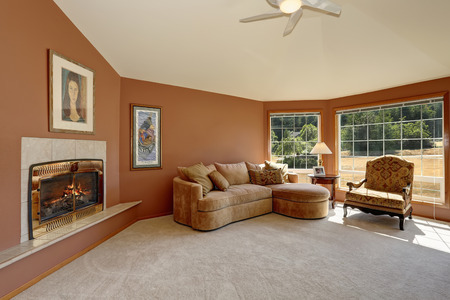 green couch: Cozy living room interior with tile fireplace and big windows. Northwest, USA