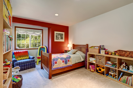 Colorful kids room interior with many toys. Northwest, USA