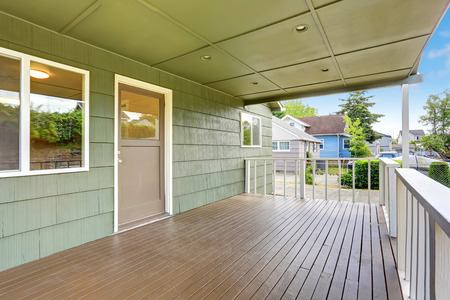 northwest: View of wooden walkout deck with white railings. Northwest, USA Stock Photo