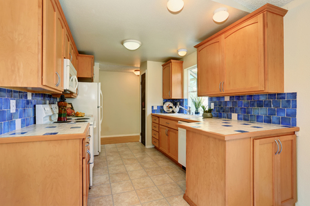 Maple Cabinets With Blue Tile Back Splash Trim And White Appliances.  Northwest