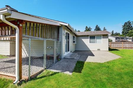 rambler: Backyard garden with cage. American Rambler house exterior. Northwest, USA