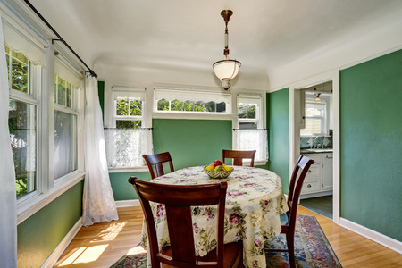 Traditional dining area with wooden table set. Open floor plan. Northwest, USA