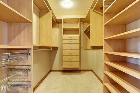 walk in closet: Large walk in closet with hardwood floor, also including many shelves and drawers. Northwest, USA