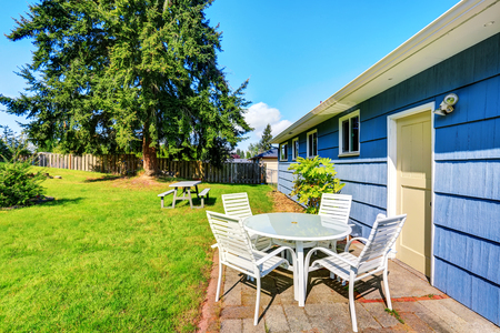 View of patio table set in the blue house back yard. Northwest, USA