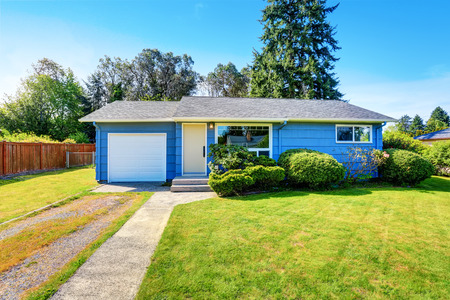 white door: Small cute blue house with driveway and trimmed hedges. Northwest, USA