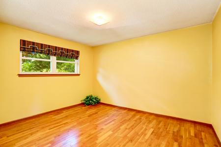 remodeled: Yellow empty room with hardwood floor and window. Northwest, USA
