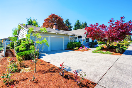 curb: Beautiful curb appeal of small American house. Two garage spaces with concrete driveway.  Northwest, USA Stock Photo