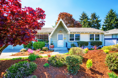Beautiful curb appeal of small American house with well kept front garden.  Northwest, USA