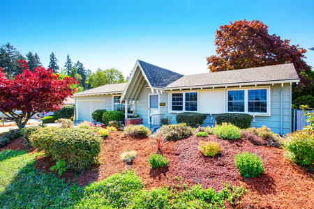 curb appeal: Beautiful curb appeal of small American house. Two garage spaces with concrete driveway.  Northwest, USA Stock Photo