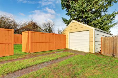 northwest: Small beige detached garage at the fenced backyard. Northwest, USA