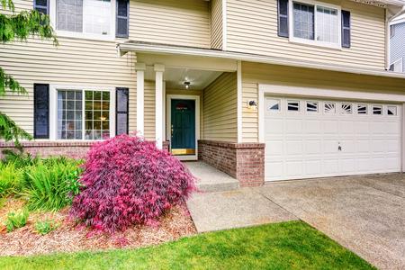 trim: American house exterior with siding trim, garage and well kept garden around. Northwest, USA Stock Photo