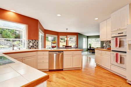 renovated: White kitchen room interior with tile counter top and hardwood floor. Open floor plan. Northwest, USA
